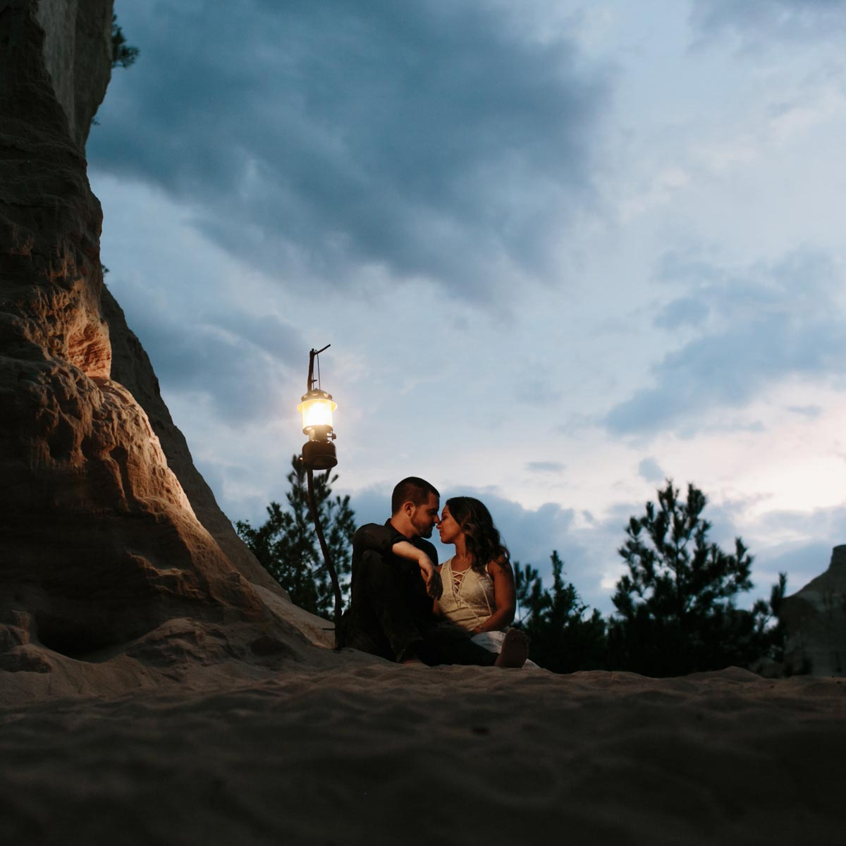 moody creative adventure engagement photos with lantern