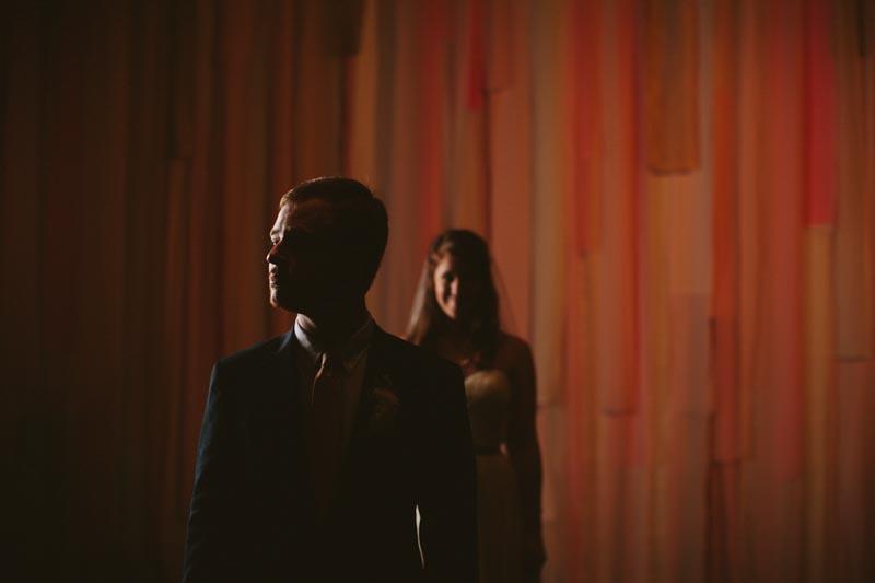 dramatic first look wedding photo DIY custom backdrop