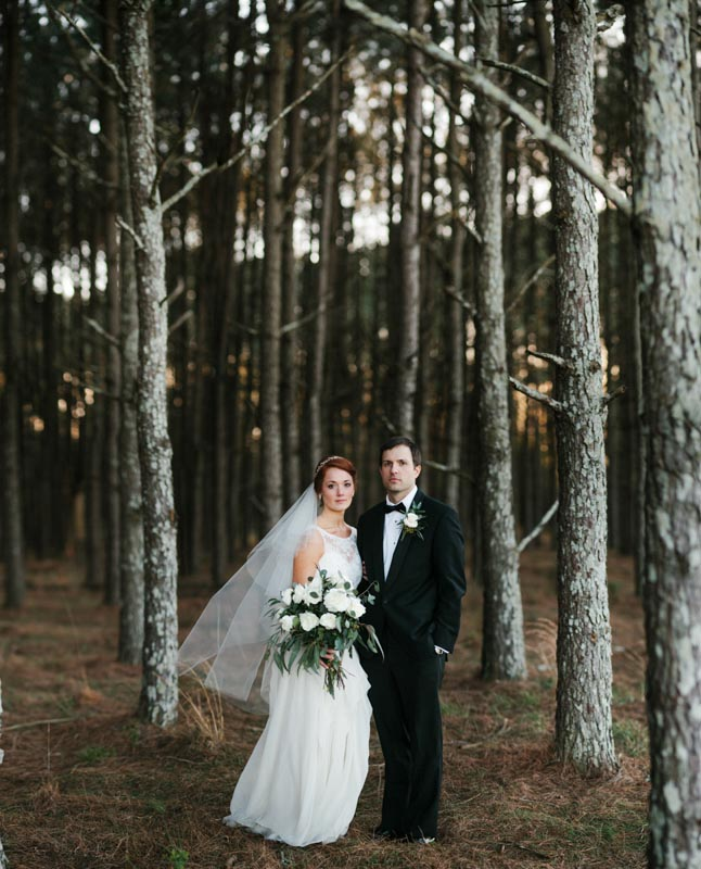 bride and groom trees edgy dramatic Frost Chapel