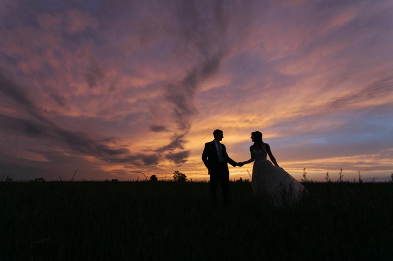 romantic sunset bride and groom wedding photo