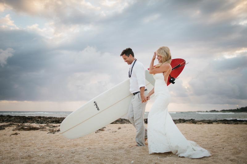 bride and groom surfing wedding dress North Shore, Hawaii