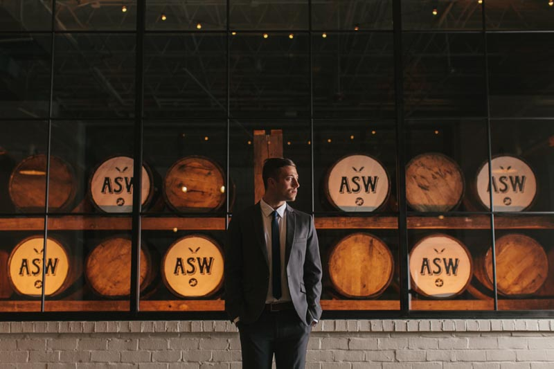 groom portrait whiskey barrels