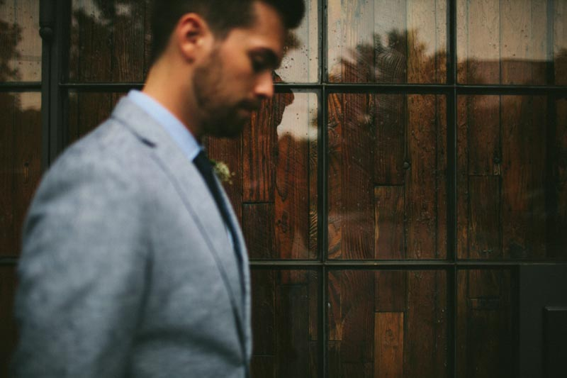 groom portrait wood window