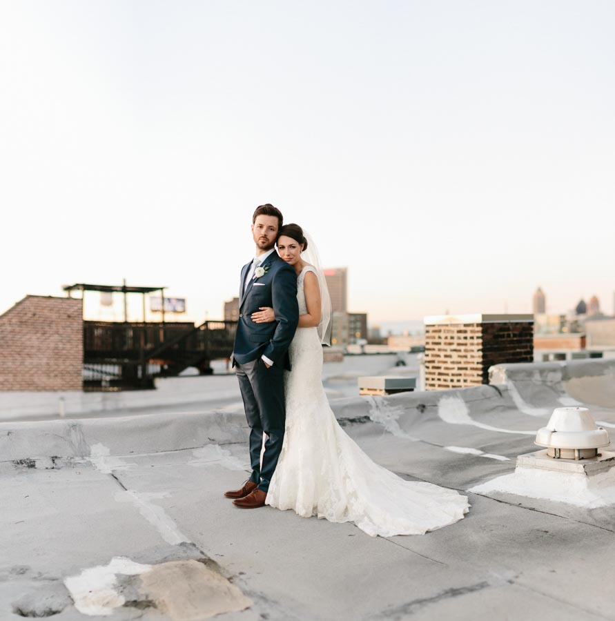 bride and groom on rooftop wedding photo intimate
