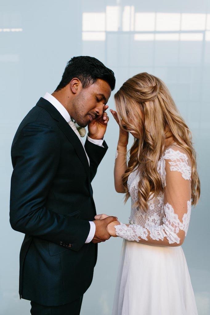 emotional wedding couple holding hands
