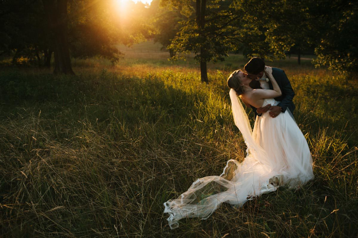 romantic sunset photo of bride and groom