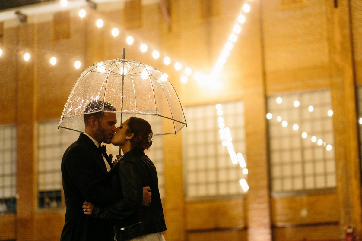 rainy wedding couple umbrella
