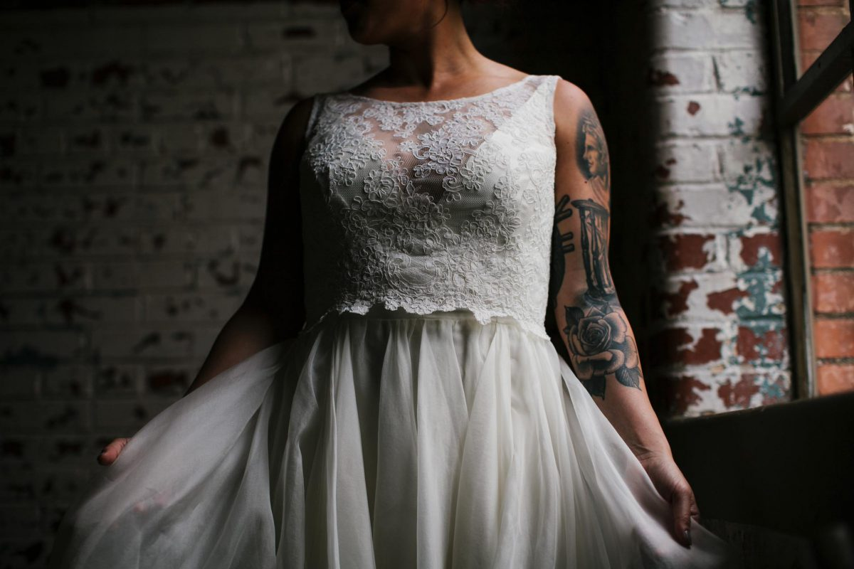 wedding dress detail bride with tattoos