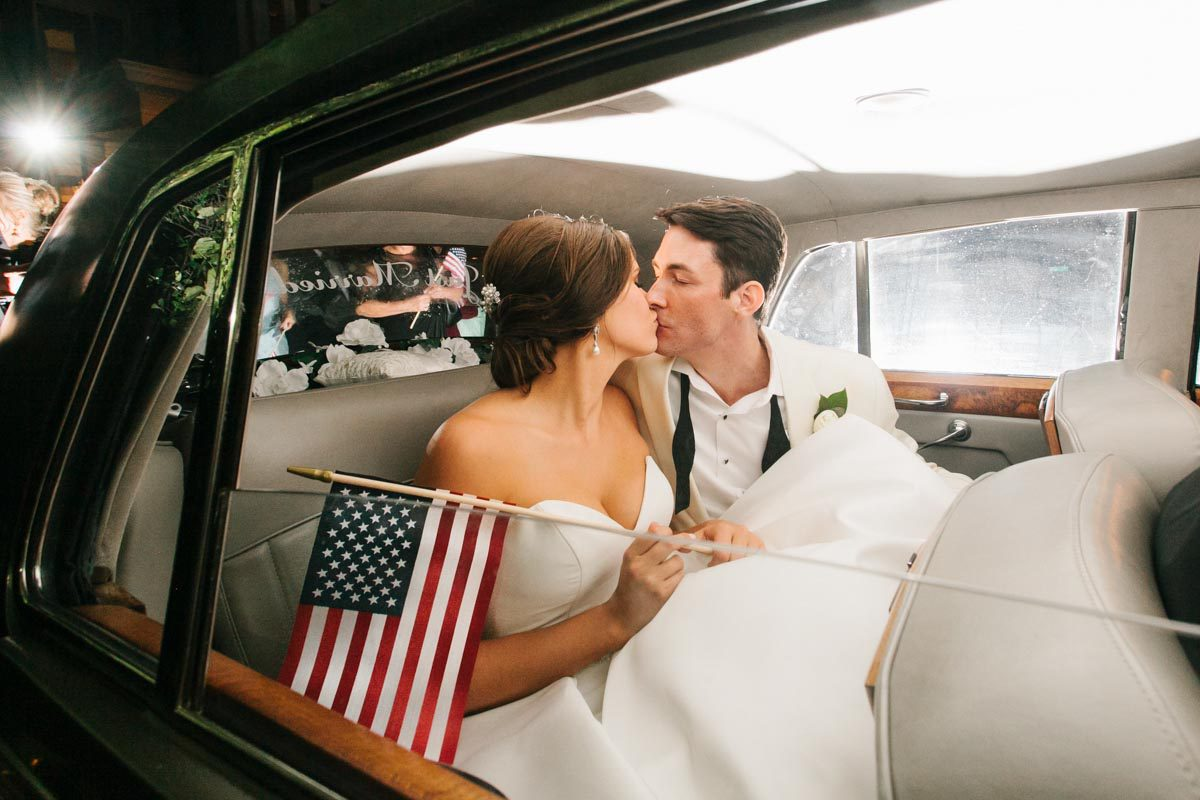 Wedding exit photo old car american flag
