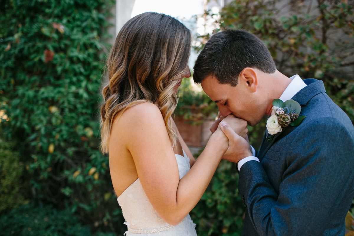 wedding couple kissing hands romantic