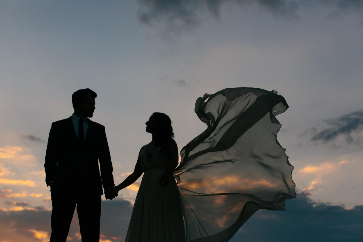 wedding couple at night sunset veil flying