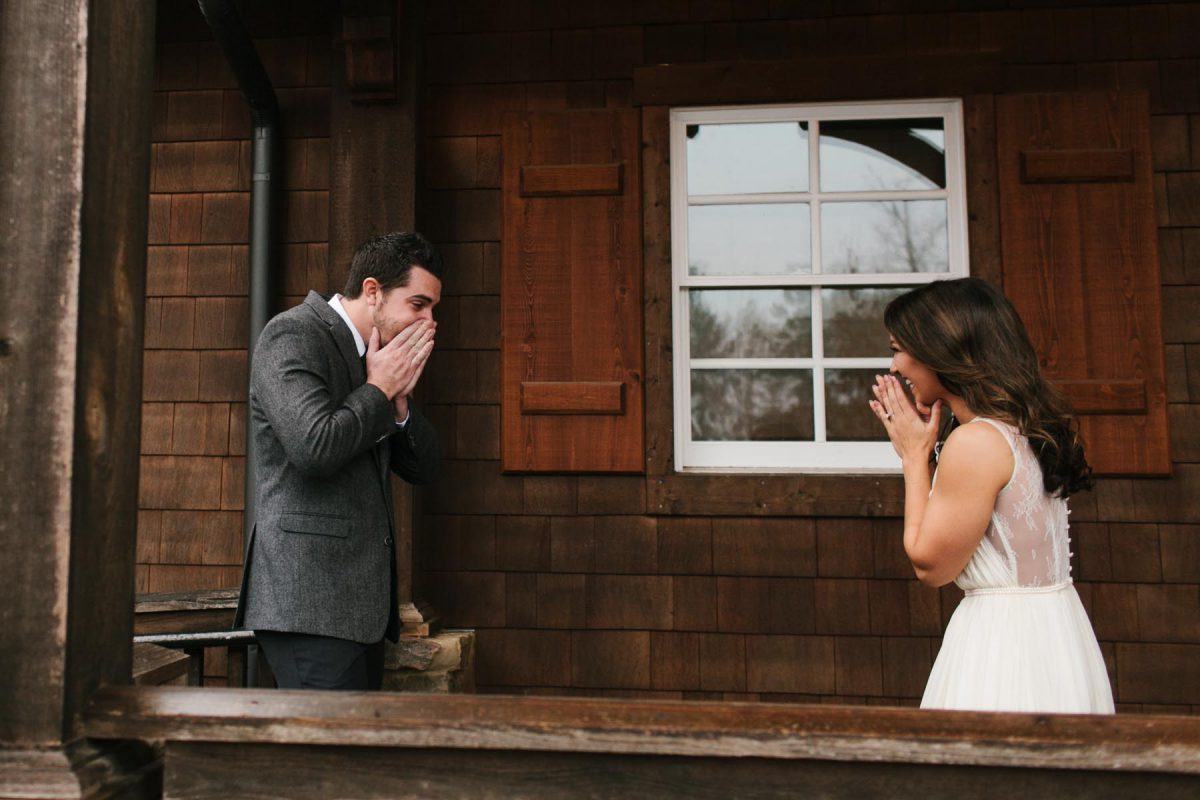 surprised first look bride and groom barn