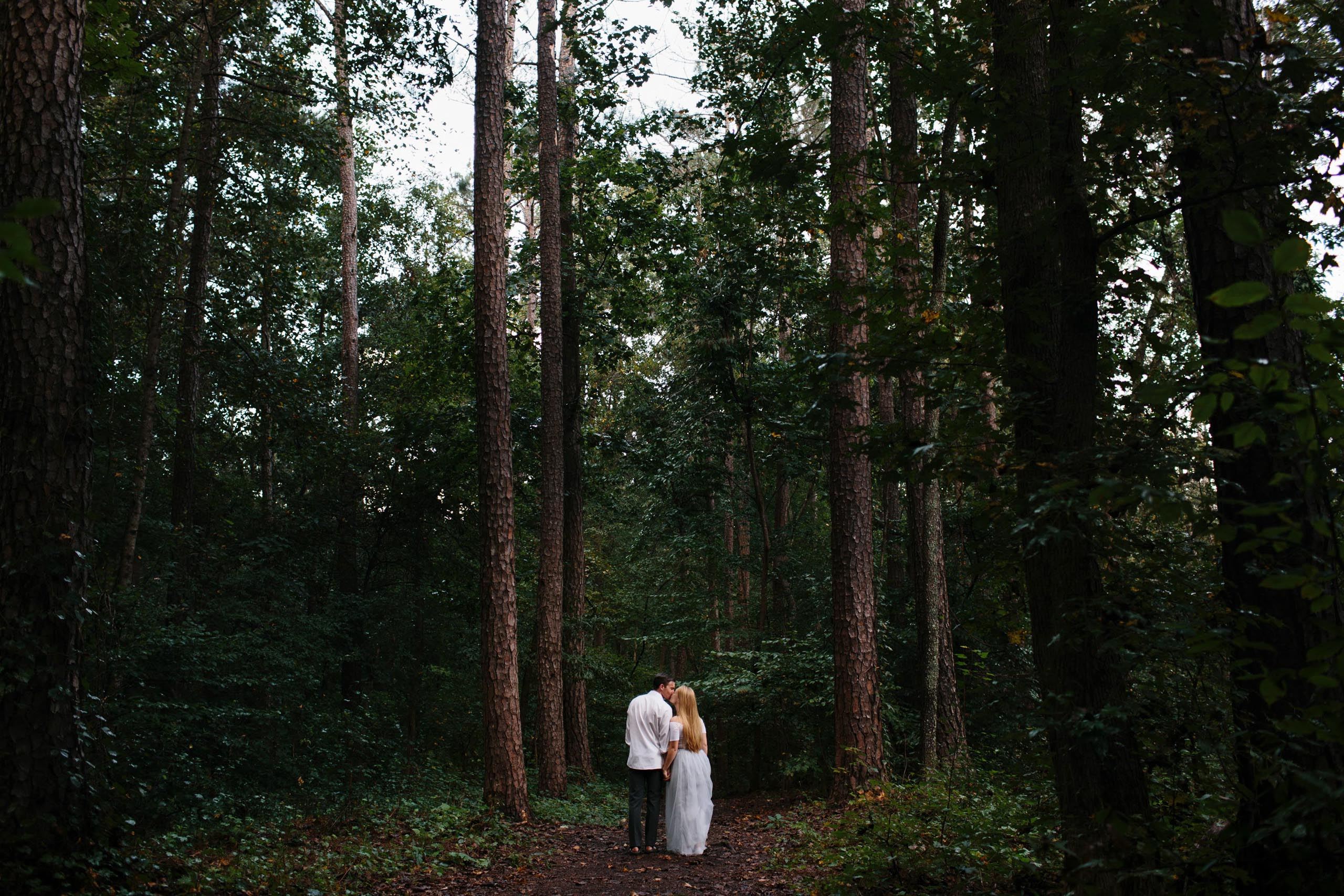 couple in woods engagement